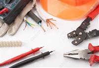 18433875-Electrician-s-tools-Hardhat-multimeter-pliers-cutter-cables-etc--Stock-Photo