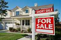 42908960-short-sale-home-for-sale-real-estate-sign-and-house-right-side-
