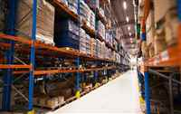 interior-large-distribution-warehouse-with-shelves-stacked-with-palettes-goods-ready-marke